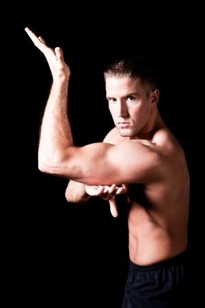 shirtless male: Muscular man isolated on black background Stock Photo
