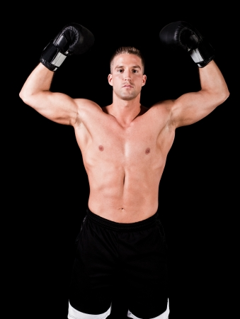 Muscular man isolated on black background photo