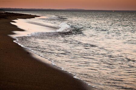 El mar con la puesta del sol Foto de archivo - 18792518