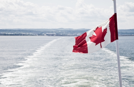 View of the sea and the flag of Canada photo