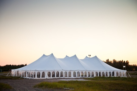 lawn party: Party or event white tent during the evening