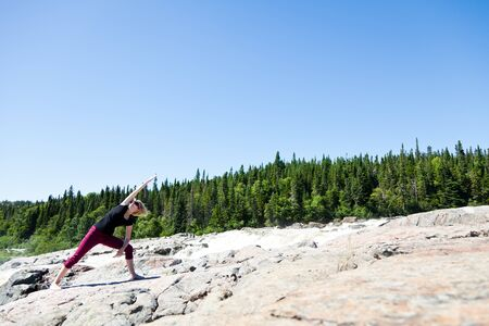 Yoga in nature with a young girl photo