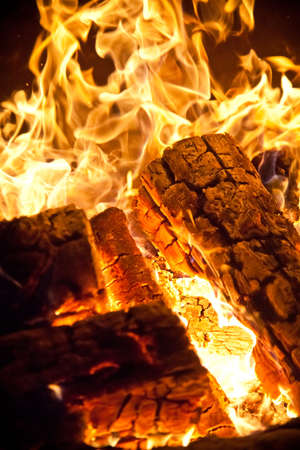 Close-up of flames and log wood burning photo