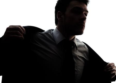 Uomo d'affari ritratto silhouette ottenere vestito - mettere la giacca Archivio Fotografico