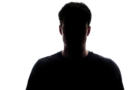 silhouettes: Typical upper body man silhouette wearing a tshirt - misterious face Stock Photo