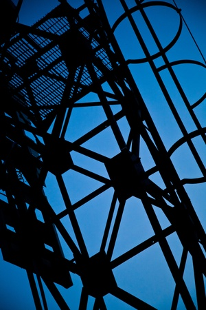 structure: Abstract metal structure silhouette and blue sky