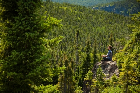 altitude: Yoga on a rock in the middle of the nature