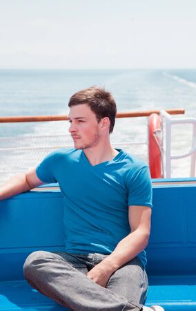 yacht people: Young man in vacation on a yacht Stock Photo