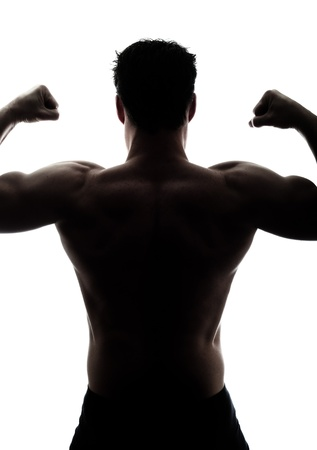 shadow: Muscular mans back in silhouette isolated on white background Stock Photo