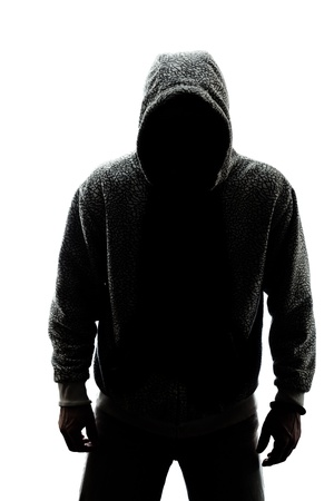 Hombre misterioso en silueta aislados sobre fondo blanco Foto de archivo