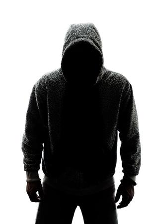 Mystérieux homme en silhouette isolé sur fond blanc Banque d'images