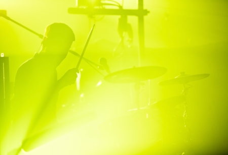drum sticks: Drumer in silhouette during a concert Stock Photo