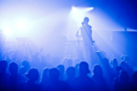 rock singer: Signer in silhouette in front of a big crowd