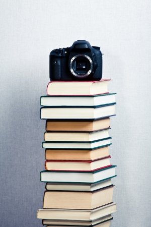 photo studio: Picture Camera on a high stack of books Stock Photo