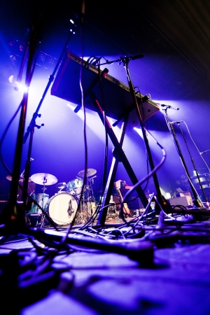 drummer: Dark and grainy image of a stage ready for a music band live performance
