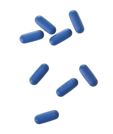 painkillers: Closeup of Blue Tablets isolated on white background Stock Photo