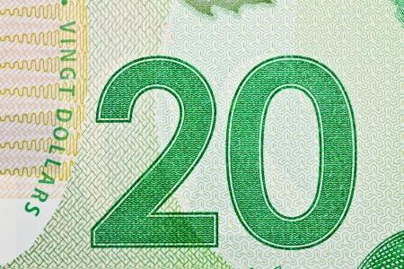 canadian currency: Extreme Closeup of New Polymer Twenty Dollar Bills