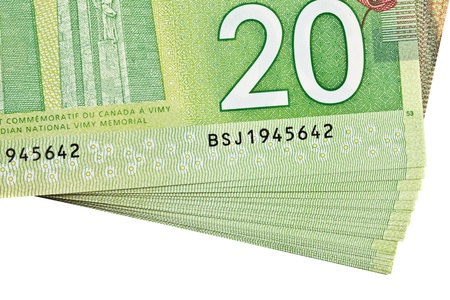 canadian dollar: A stack of new polymer Canadian twenty dollar bills detail of a serial number, isolated on white background Stock Photo