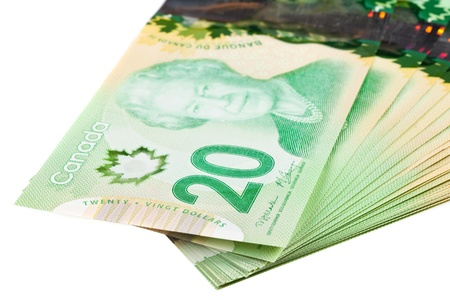 polymer: A stack of new polymer Canadian twenty dollar bills, isolated on white background