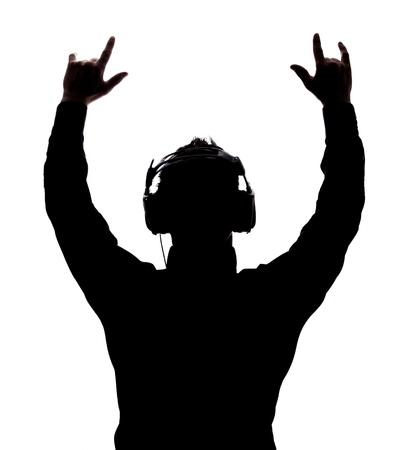 auriculares dj: El hombre balance�ndose con los auriculares en silueta aislados sobre fondo blanco Foto de archivo