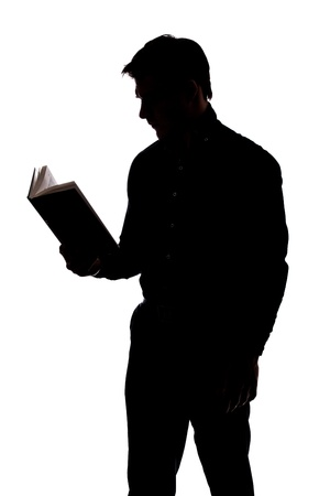 Man reading a book in silhouette and isolated on White background photo