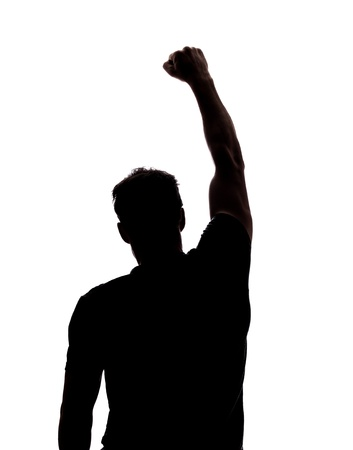 human fist: Fist in the air in silhouette isolated over white background