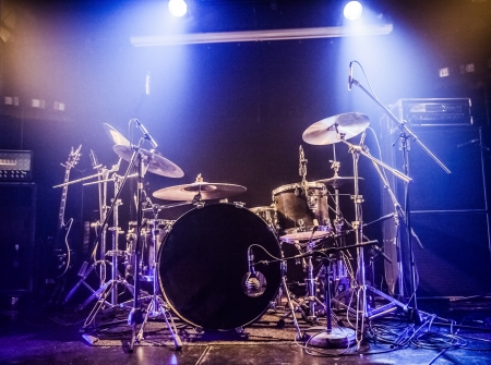 performing: Drumkit on empty stage waiting for musicians