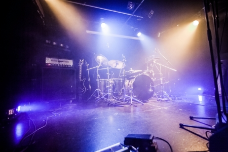 Drumkit on empty stage waiting for musicians  photo