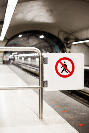 Safety Interdiction Sign (Do not Cross) on a Underground Subway Platform