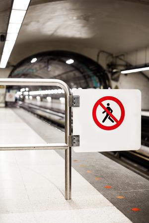 rail cross: Safety Interdiction Sign (Do not Cross) on a Underground Subway Platform