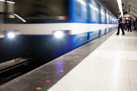 Colorful Underground Subway Train and Platform with motion blur