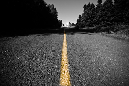 Empty Country road with Yellow Dividing line at Night photo