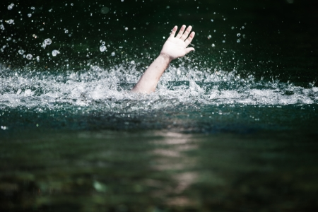 Moving Hand of Someone Drowning and in Need of Help photo
