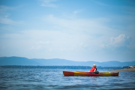 Young Woman Relaxing on a Kayak and Enjoying the Moment of Freedom photo