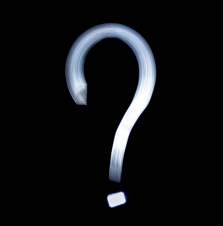 Question mark Symbol Icon Using Light Painting Technique isolated over black Background photo