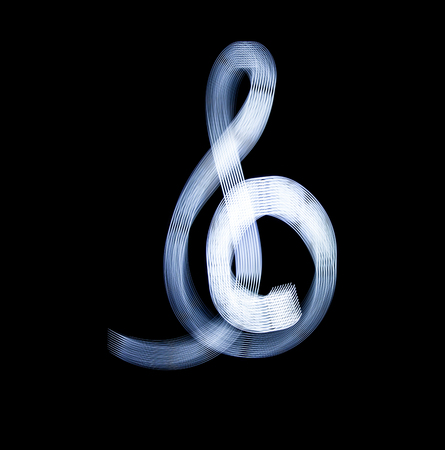 g clef: Sol Key Symbol Using Light Painting Technique isolated over black Background