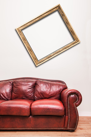 red couch: Luxurious Red Leather Couch in front of a blank crooked frame to ad your text, logo, images, etc.