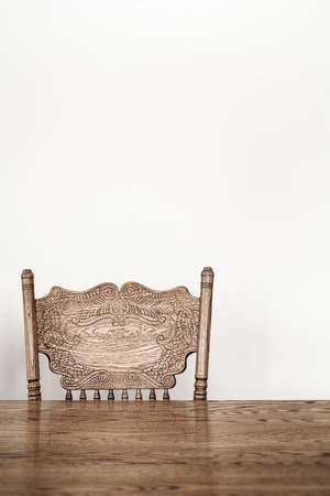 Wooden Dining room table and chair details and blank wall for your text, image or logo. photo