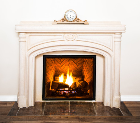 Luxurious White Marble Fireplace Detail and empty white wall photo