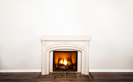 Luxurious White Marble Fireplace and empty wall for your text, logo, images, etc