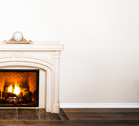 Luxurious White Marble Fireplace and empty wall for your text, logo, images, etc photo