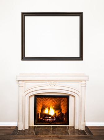 Luxurious White Marble Fireplace and empty wood frame for your text, logo, images, etc photo