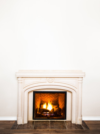 mantel: Luxurious White Marble Fireplace and empty wall for your text, logo, images, etc