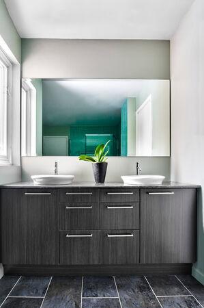bathroom mirror: Modern Bathroom with big mirror. Soft Green Pastel Colors Stock Photo