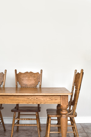 dining room: Wooden Dining room table and chair details and blank wall for your text, image or logo. Stock Photo