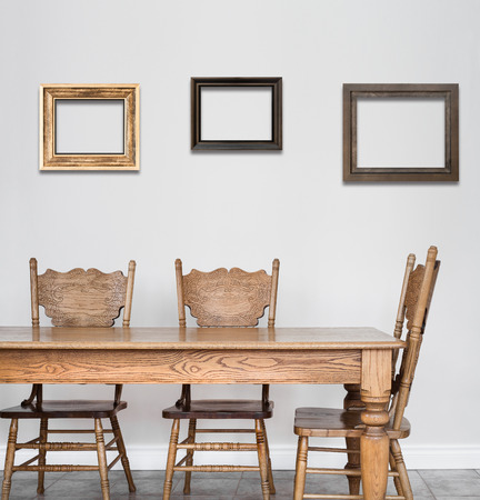 room for text: Wooden Dining room table and chair details and blank frames for your text, image or logo or even family pictures ! Stock Photo