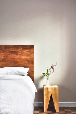 Beautiful Clean and Modern Bedroom with empty wall to add some text, logo, image, etc. photo