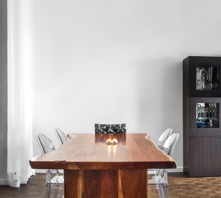 Modern and Contemporary dining room table and decorations with blank wall for your text, image or logo. photo