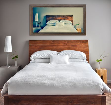 Beautiful Clean and Modern Bedroom with fun Canvas on the Wall that is a repetition or infinity concept photo