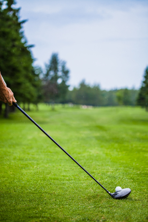 Golfer on a Golf Course on the Start with lot of Copyspace for your text (preparation) photo